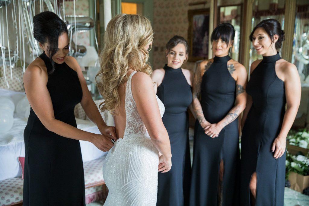 bridesmaid assit dressing bride kilworth house hotel north kilworth leicestershire oxford wedding photographers