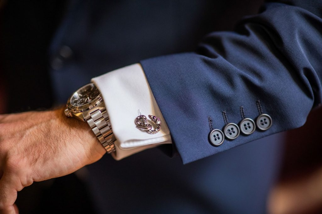 groom checks watch marriage ceremony lansdowne club mayfair london oxford wedding photography