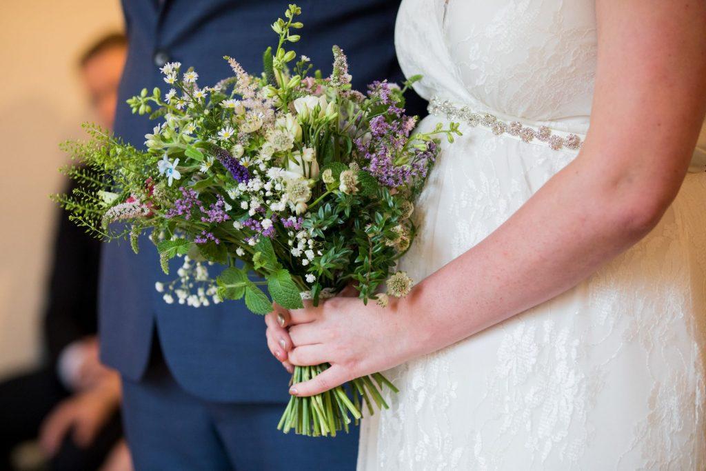 bride holds bouquet registry office roysse court abingdon oxford wedding photographer