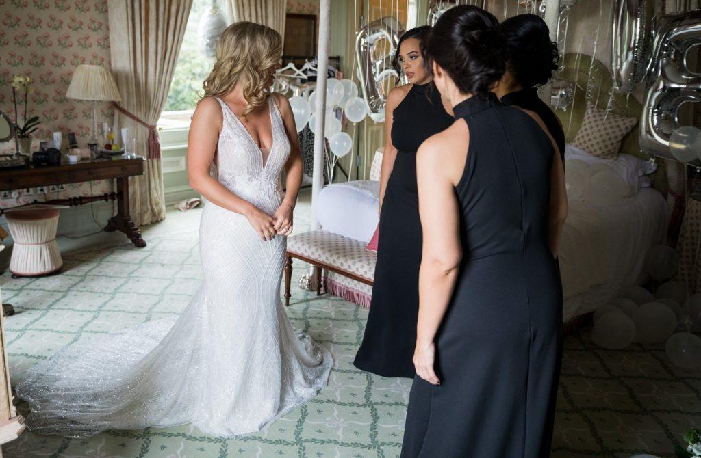 bridesmaids admire brides dress kilworth house hotel north kilworth leicestershire oxford wedding photography