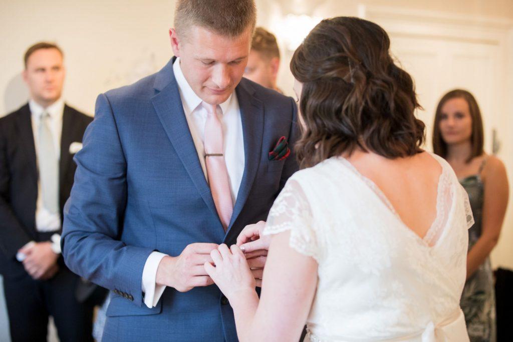 bride groom exchange rings registry office roysse court abingdon oxford wedding photographers