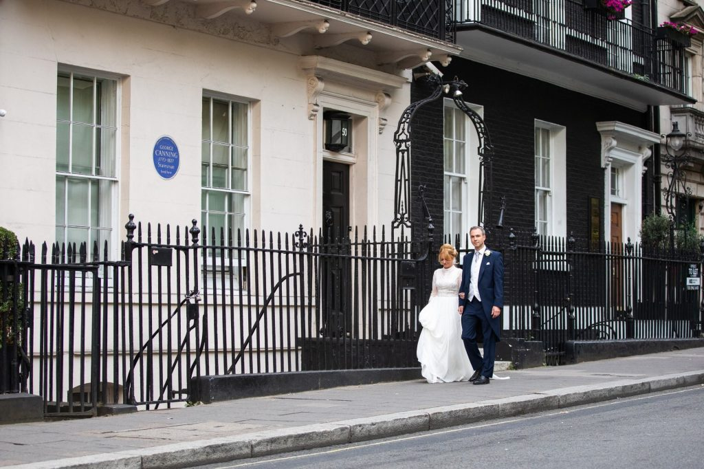 bride groom walk towards lannsdowne club mayfair london oxford wedding photographers