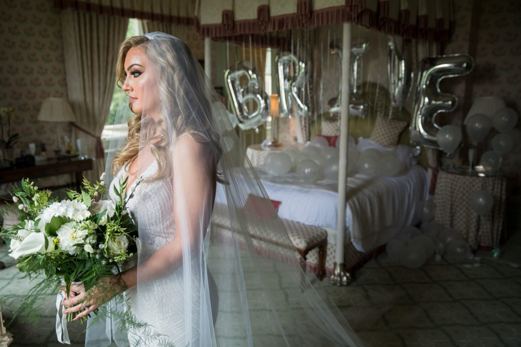 bride with bouquet bridal prep bedroom kilworth house hotel north kilworth leicestershire oxfordshire wedding photographers