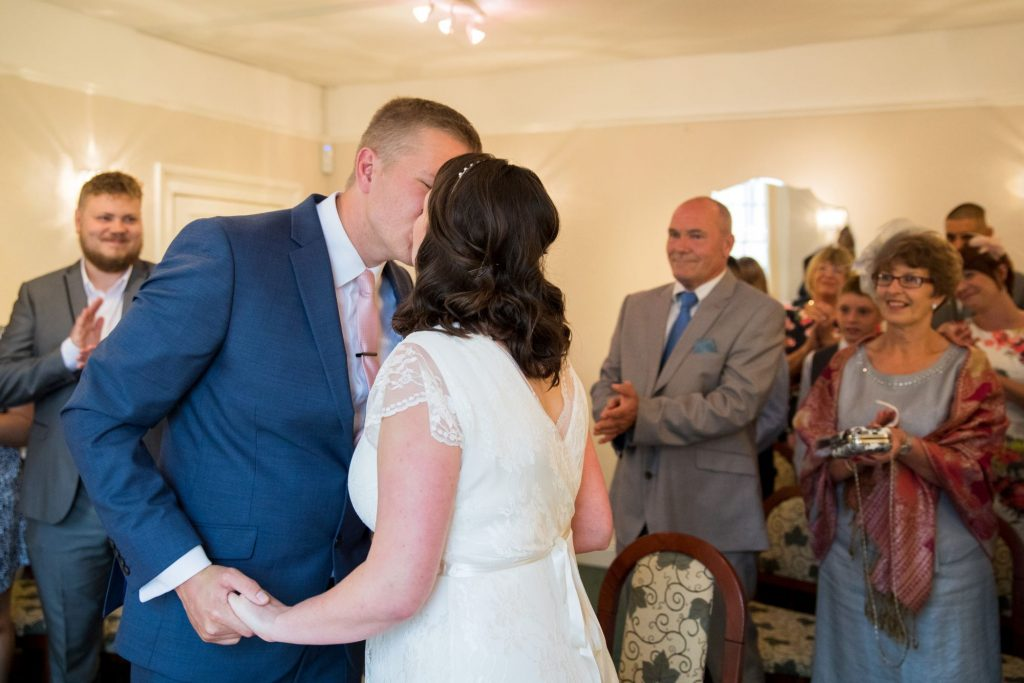 bride groom first kiss registry office roysse court abingdon oxfordshire wedding photographer