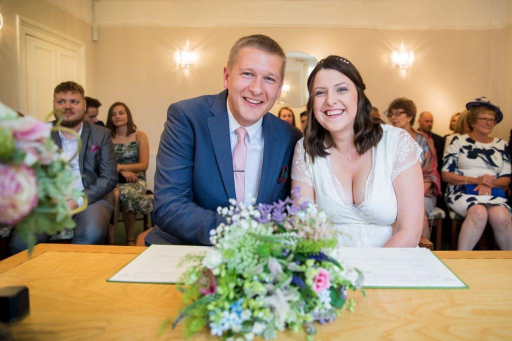 bride groom sign register roysse court offices abingdon oxfordshire wedding photographers