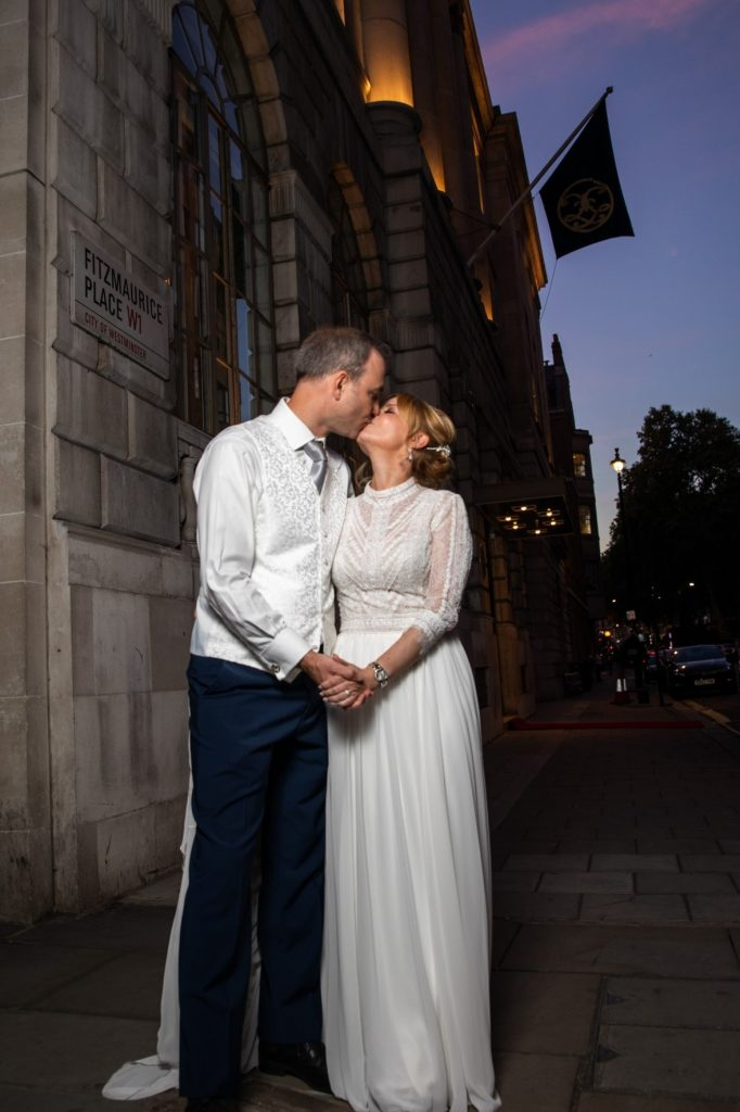 bride groom street kiss lansdowne club marriage ceremony mayfair london oxfordshire wedding photographer