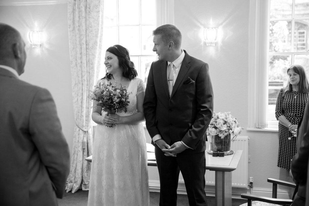 bride groom walk down aisle registry office roysse court abingdon oxfordshire wedding photographry