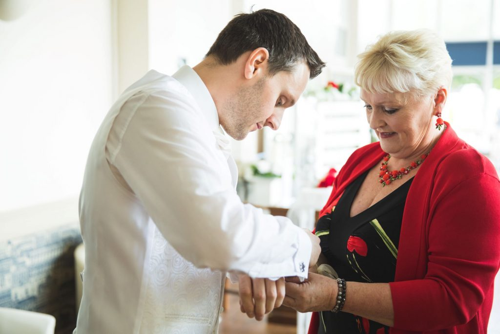 grooms mother fastens cufflinks the wroxeter hotel shrewsbury shropshire oxford wedding photographer