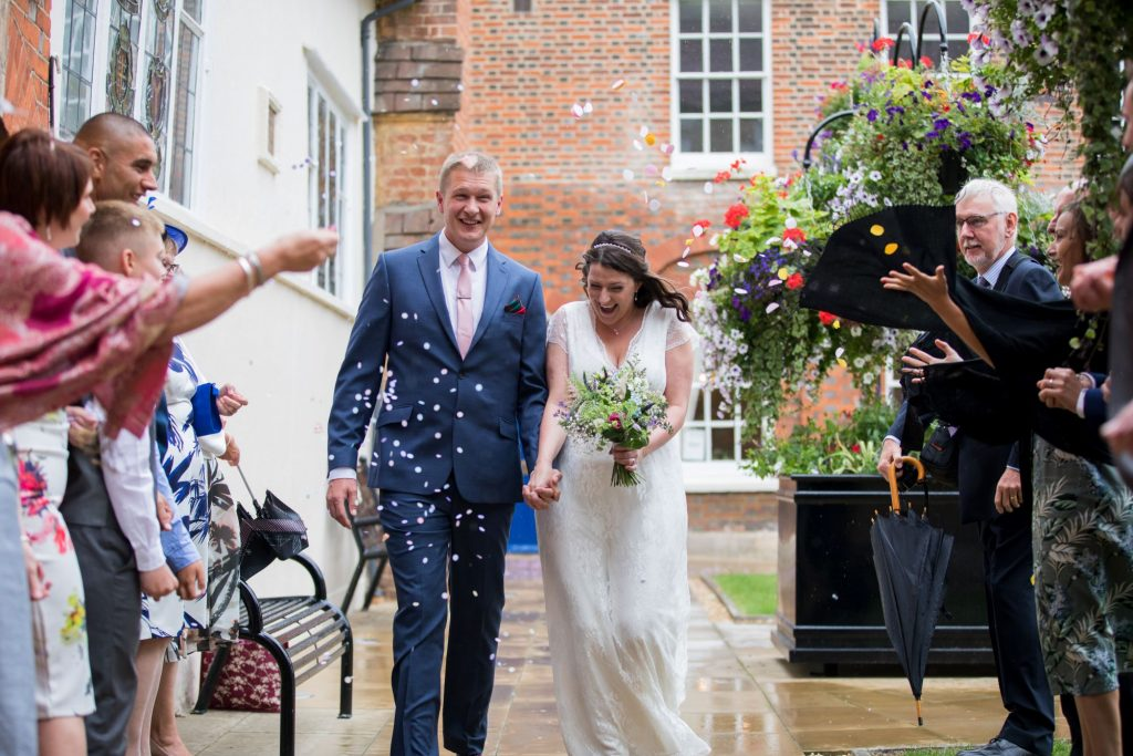 guests throw confetti registry office roysse court abingdon oxford wedding photographer