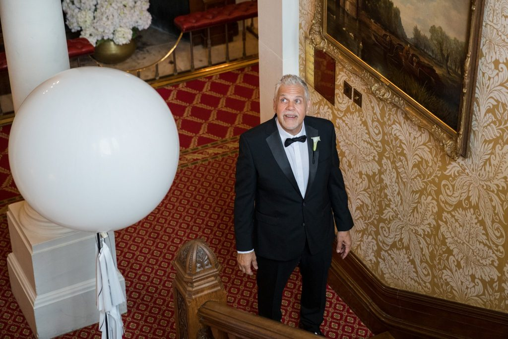 father of bride ascends staircase kilworth hourse hotel north kilworth leicestershire oxfordshire wedding photographers