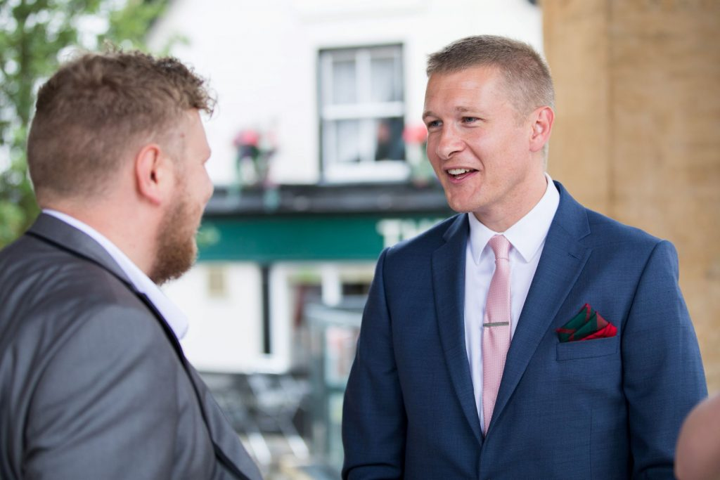 laughing groom guest registry office ceremony roysse court abingdon oxfordshire wedding photographer
