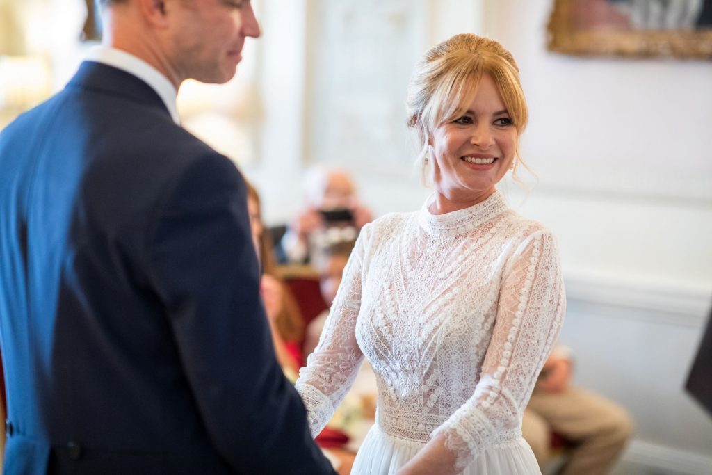 smiling bride lansdowne club marriage ceremony mayfair london oxford wedding photographer