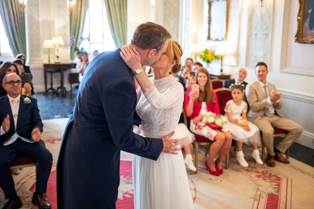 bride groom first kiss lansdowne club marriage ceremony mayfair london oxford wedding photography