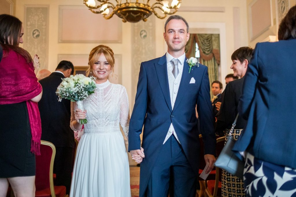 bride groom walk down aisle lansdowne club mayfair london oxfordshire wedding photographers