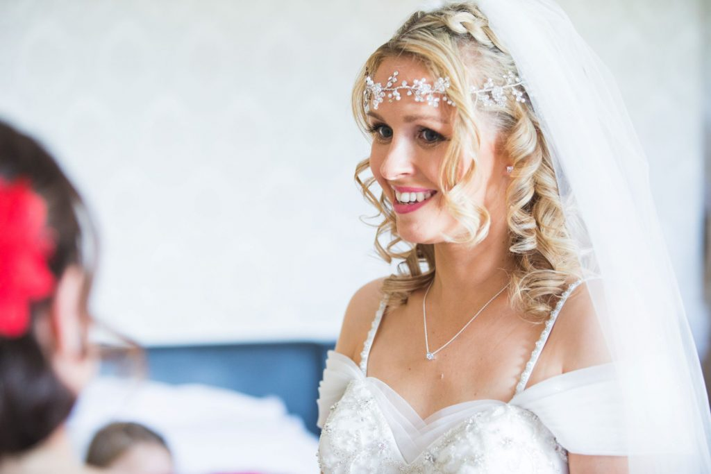 bridesmaid smiling bride the wroxeter hotel shrewsbury shropshire oxford wedding photographers