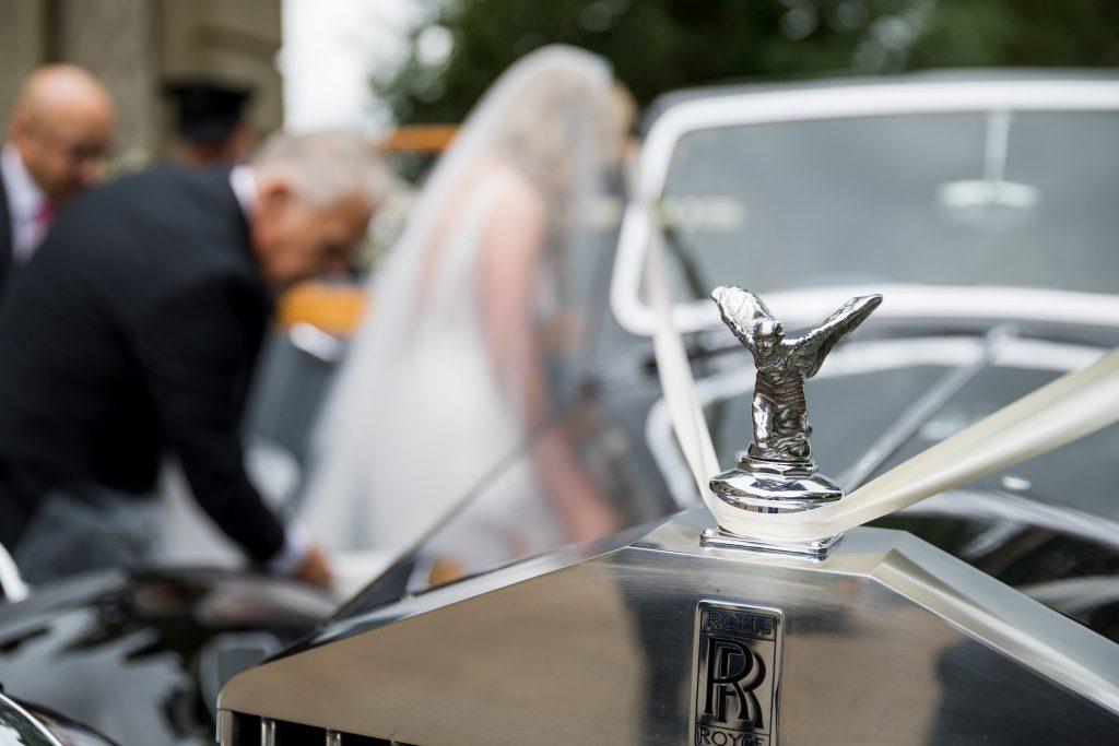 bride enters bridal car kilworth house hotel north kilworth leicestershire oxfordshire wedding photographers