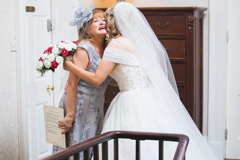 bride hugs mother the wroxeter hotel shrewsbury shropshire oxfordshire wedding photographer