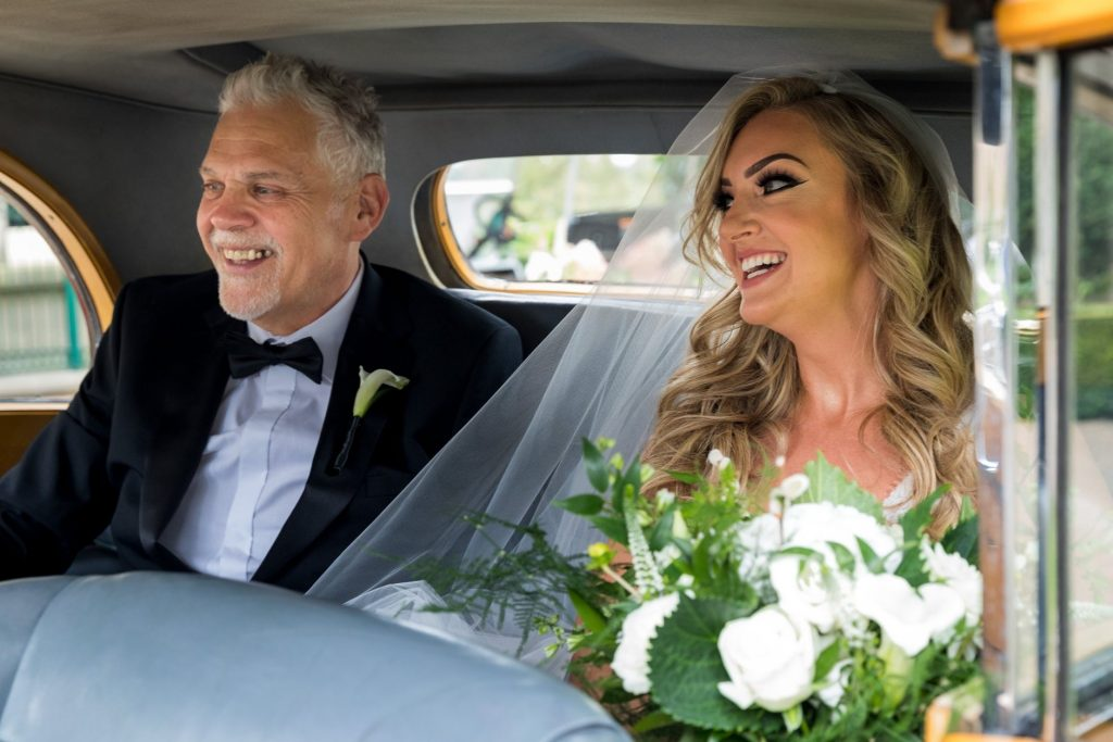 smiling bride father of bride inside bridal car kilworth house hotel north kilworth leicestershire oxfordshire wedding photography