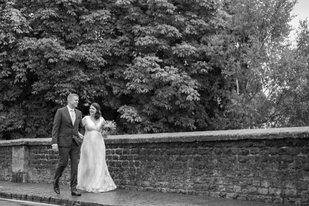 bride groom cross bridge registry office ceremony roysse court abingdon oxfordshire wedding photography