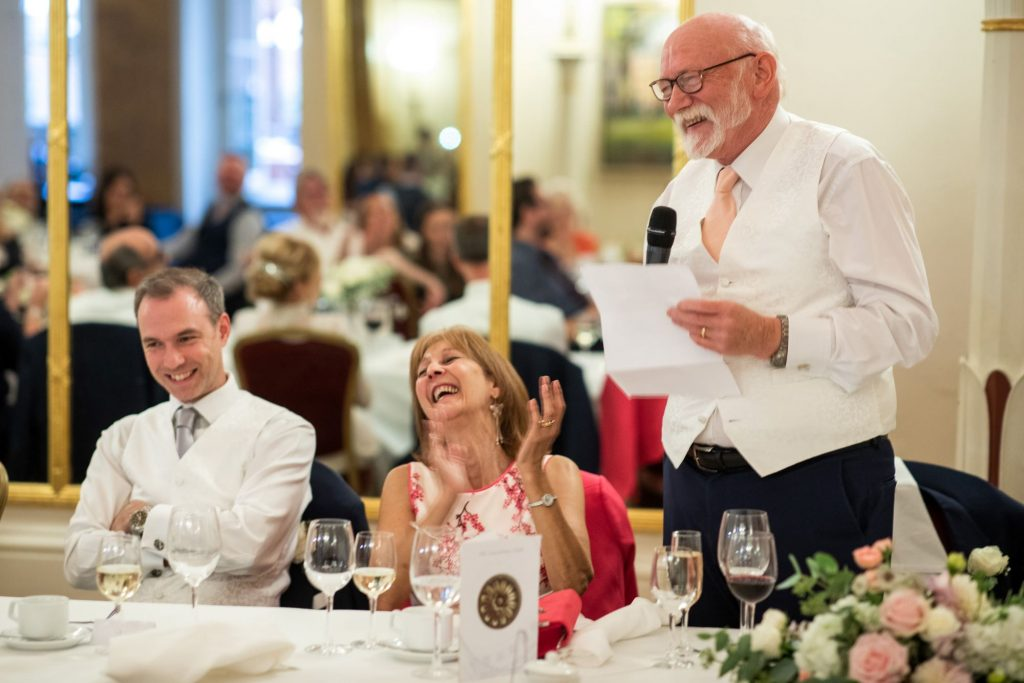 groom laughs top table speech lansdowne club mayfair london oxford wedding photography