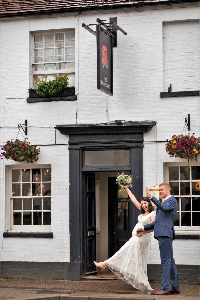happy bride groom outside broad face pub reception abingdon oxfordshire oxford wedding photographer
