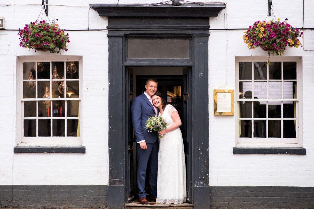 bride groom formal portrait broad face pub doorway abingdon oxfordshire oxford wedding photographers