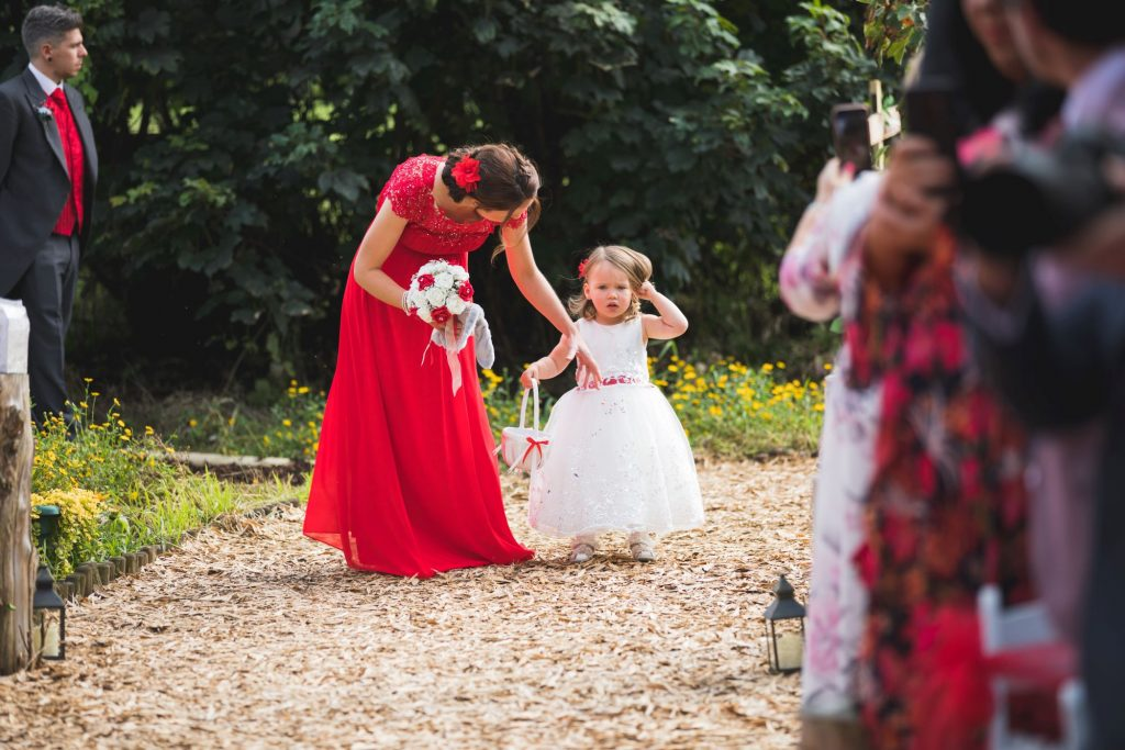bridesmaid flowergirl walk down aisle woodland ceremony wroxeter hotel shrewsbury shropshire oxfordshire wedding photographer