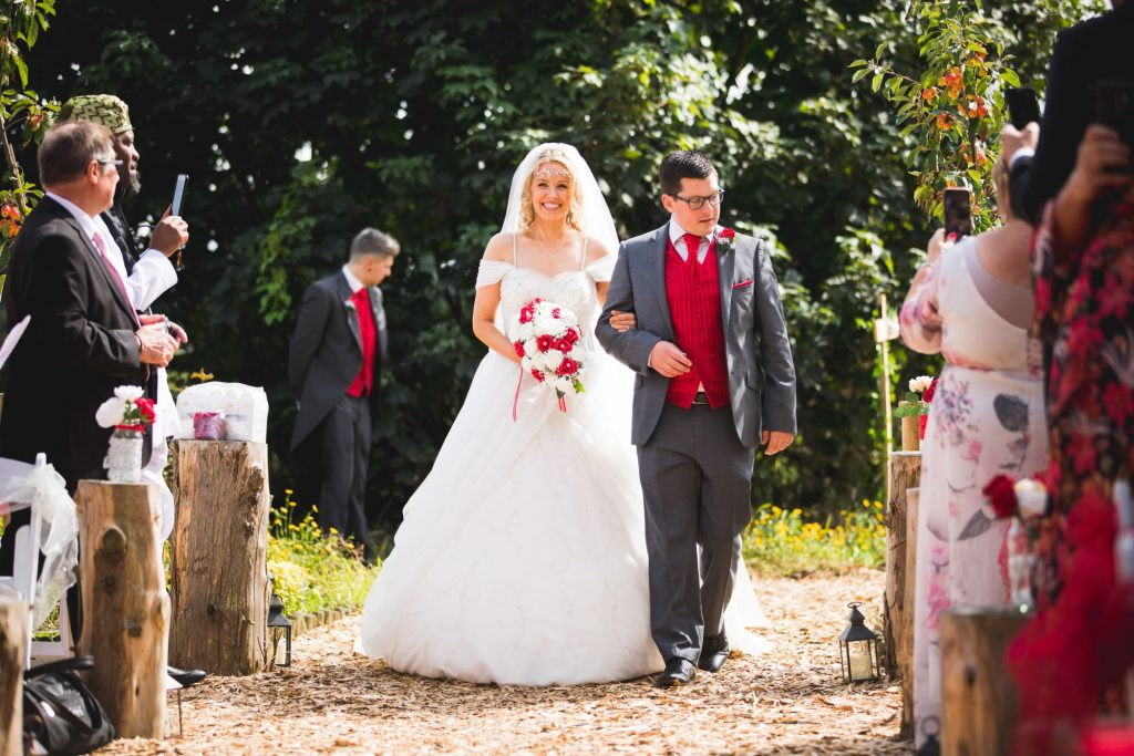 brides walk down aisle woodland ceremony wroxeter hotel shrewsbury shropshire oxfordshire wedding photographers