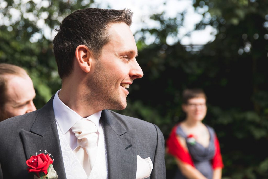smiling groom awaits bride woodland ceremony wroxeter hotel shrewsbury shropshire oxfordshire wedding photography