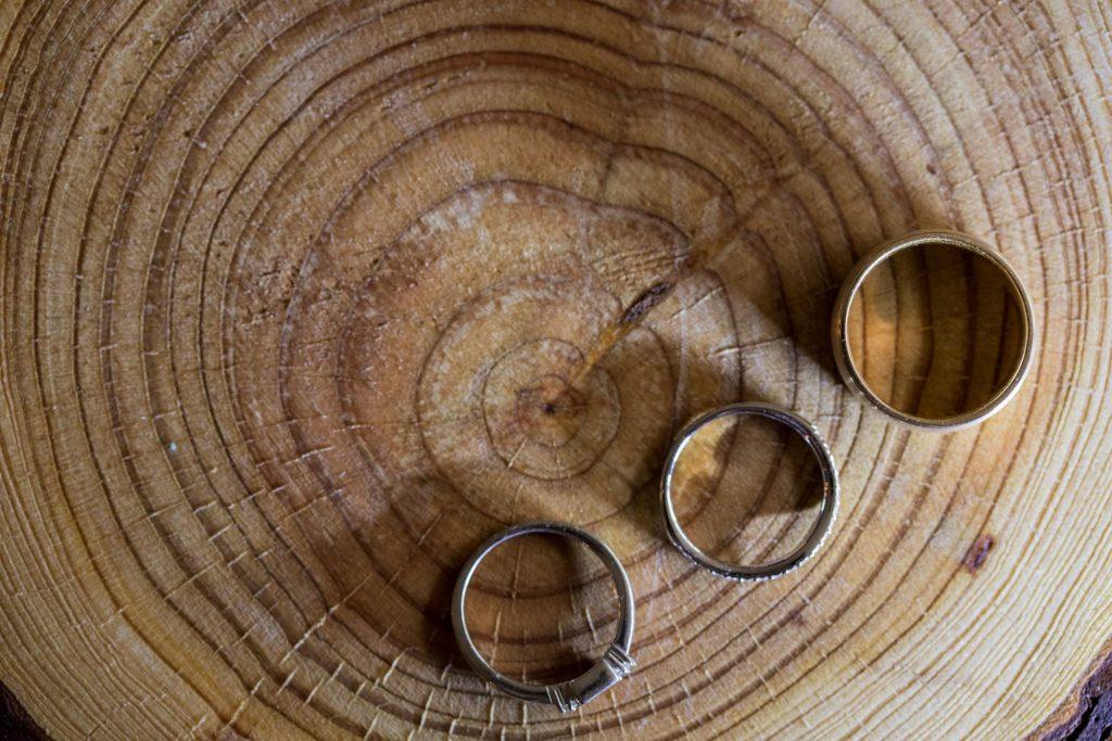 wood table displays bride groom rings broad face pub reception abingdon oxfordshire wedding photographers