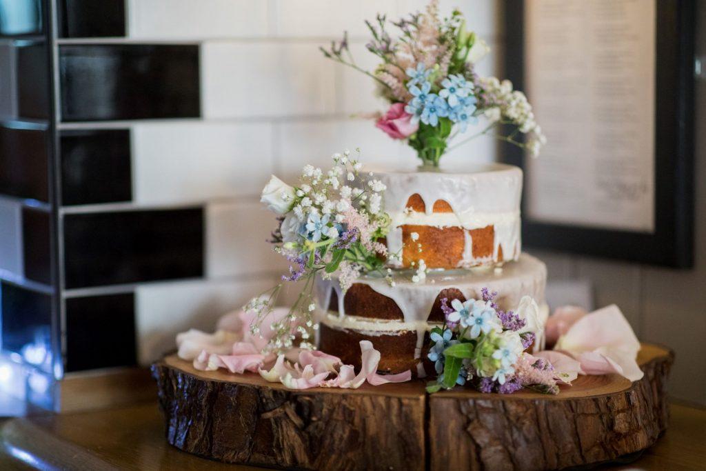 bride grooms decorated cake broad face pub reception abingdon oxfordshire wedding photography