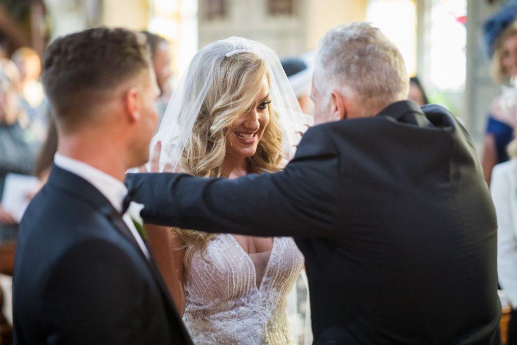 father of bride unveils bride st marys catholic church husbands bosworth leicestershire oxford wedding photographers