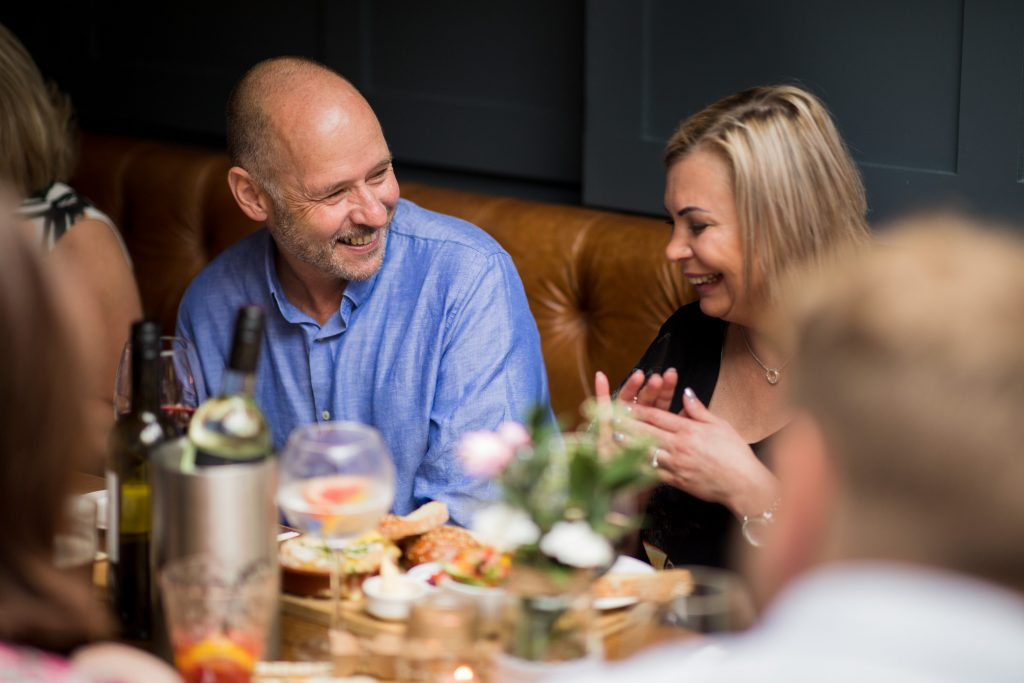 laughing dinner guests broad face pub reception abingdon oxfordshire oxford wedding photographer