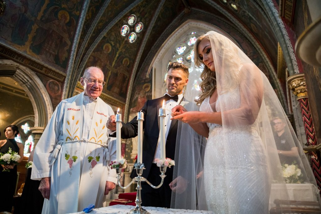 bride groom light candles st marys catholic church husbands bosworth leicestershire oxford wedding photographers