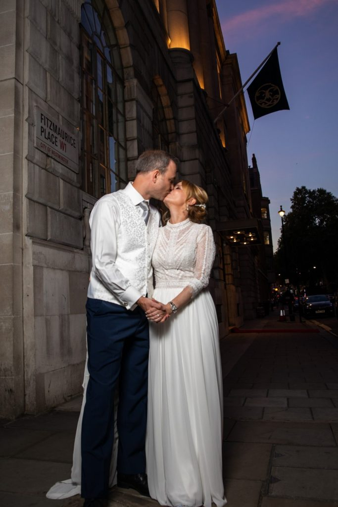 bride groom mayfair street kiss lansdowne club london oxfordshire wedding photography