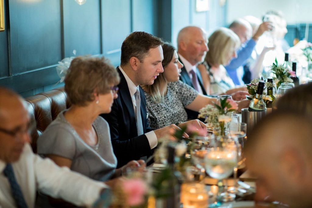 guests enjoy dinner reception broad face pub reception abingdon oxfordshire oxford wedding photographers