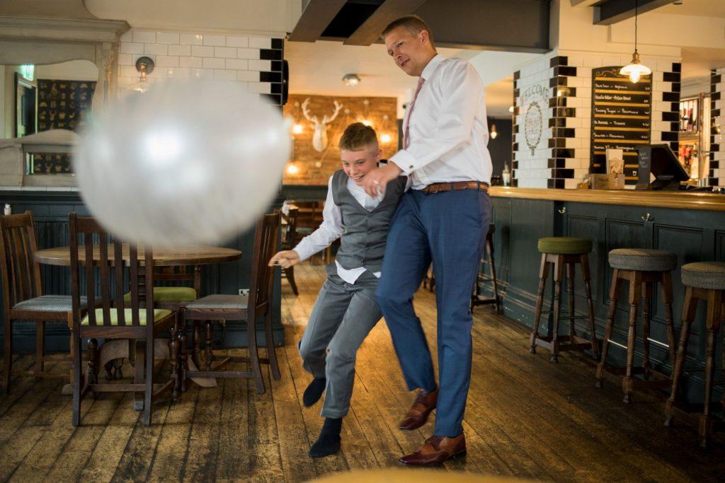 groom young guest play balloon footbal broad face pub reception abingdon oxfordshire oxford wedding phototgraphy