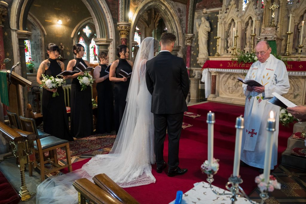 priest reads marriage service st marys catholic church husbands bosworth leicestershire oxford wedding photography