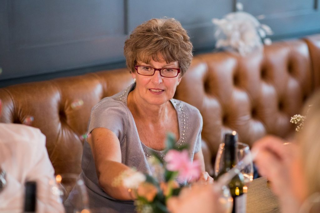 guest enjoys reception broad face pub abingdon oxfordshire wedding photographer