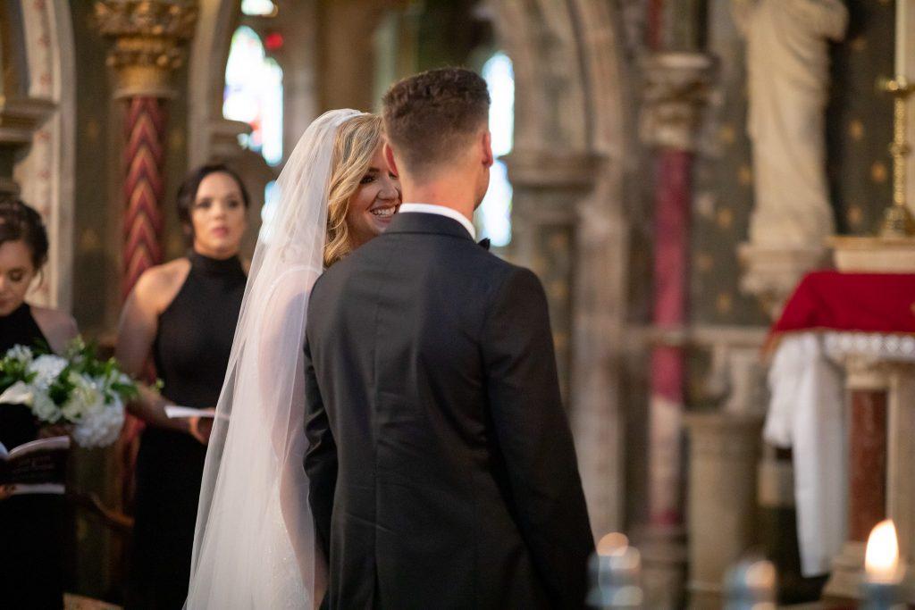 smiling bride st marys catholic church husbands bosworth leicestershire oxfordshire wedding photographers