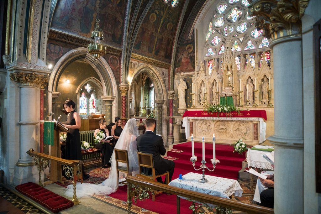 bride groom seated marriage ceremony st marys catholic church husbands bosworth leicestershire oxford wedding photographer