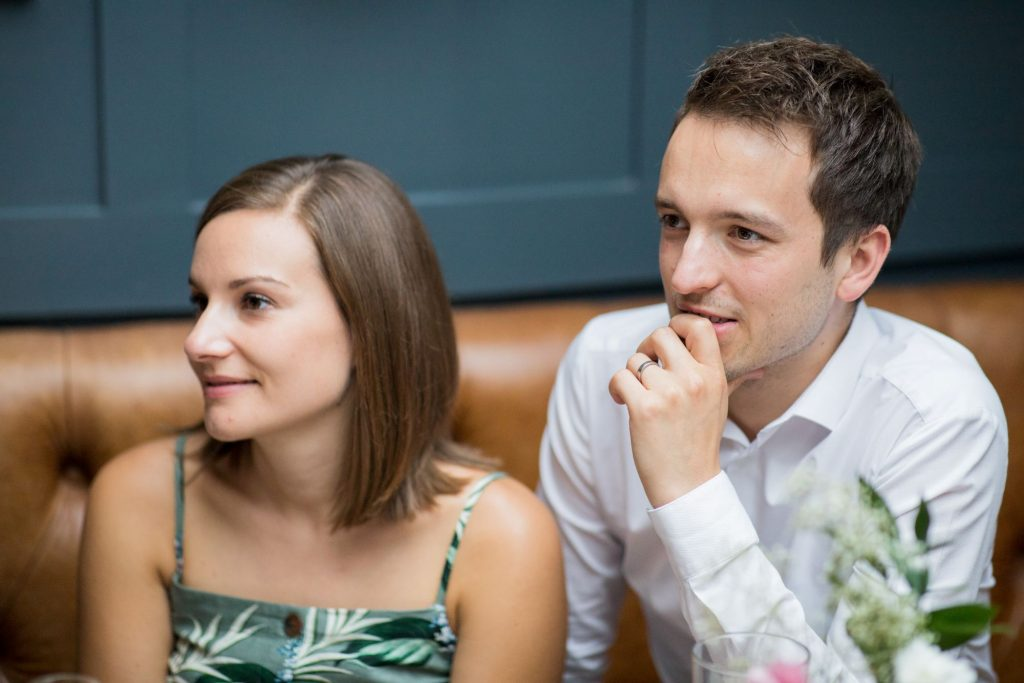 couple hear grooms speech broad face pub reception abingdon oxfordshire oxford wedding photographers