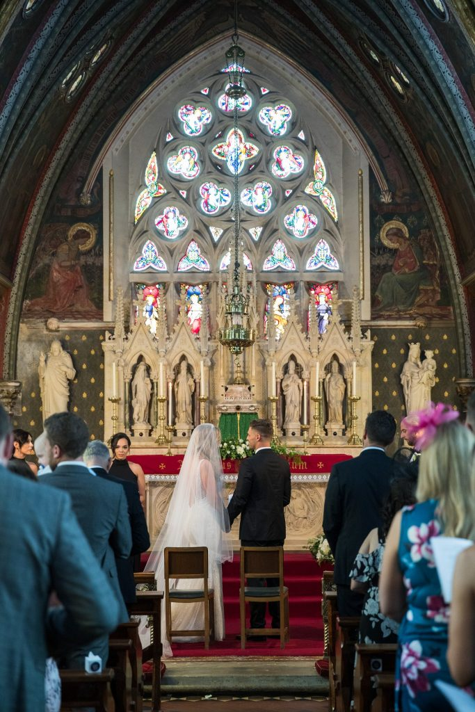 bride groom hold hands st marys catholic church husbands bosworth leicestershire oxford wedding photography