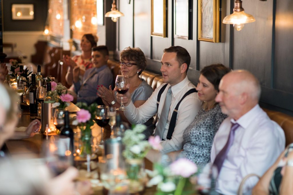 guests enjoy grooms speech broad face pub reception abingdon oxfordshire oxford wedding photography