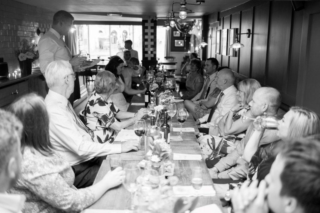 groom reads speech reception guests listen broad face pub abingdon oxfordshire wedding photographer