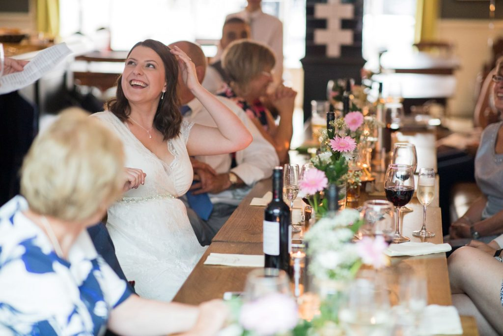 bride hears grooms speech broad face pub reception abingdon oxfordshire wedding photographers