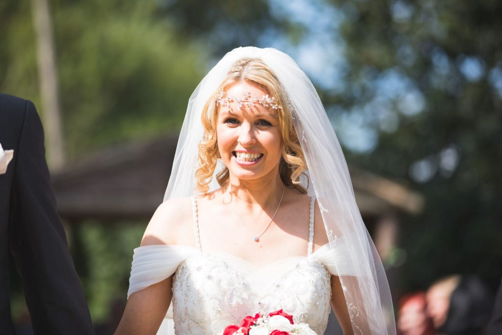 smiling bride just married woodland ceremony wroxeter hotel shrewsbury shropshire oxford wedding photographer
