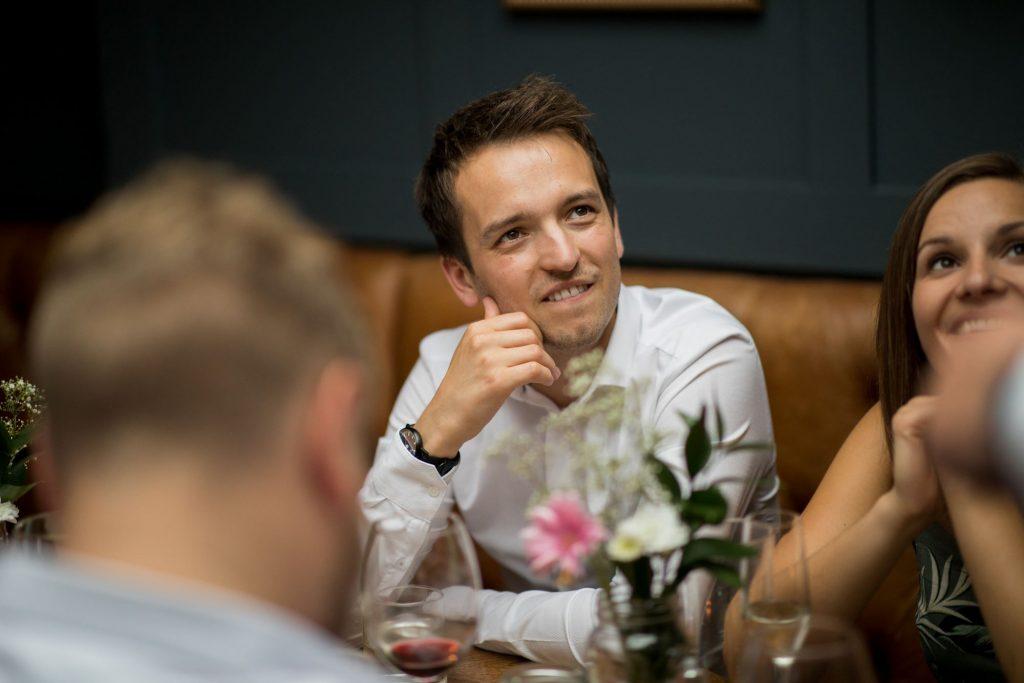 smiling guests enjoy grooms speech broad face pub dinner reception abingdon oxfordshire oxford wedding photographer