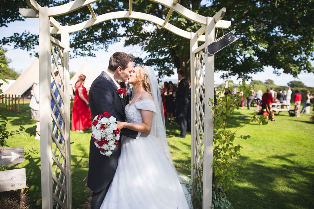 bride groom garden archway kiss wroxeter hotel shrewsbury shropshire oxfordshire wedding photographer