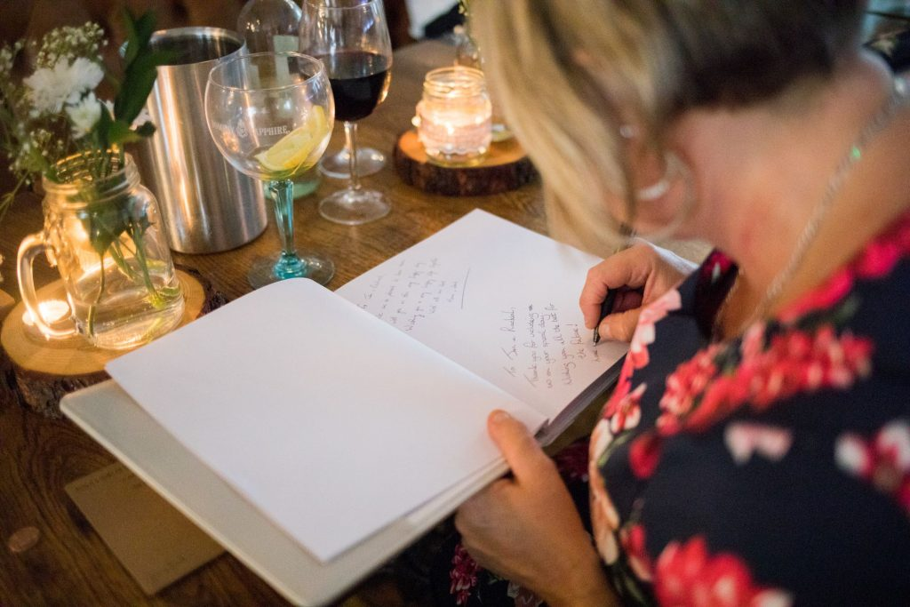 signing guest book broad face pub reception abingdon oxfordshire oxford wedding photography